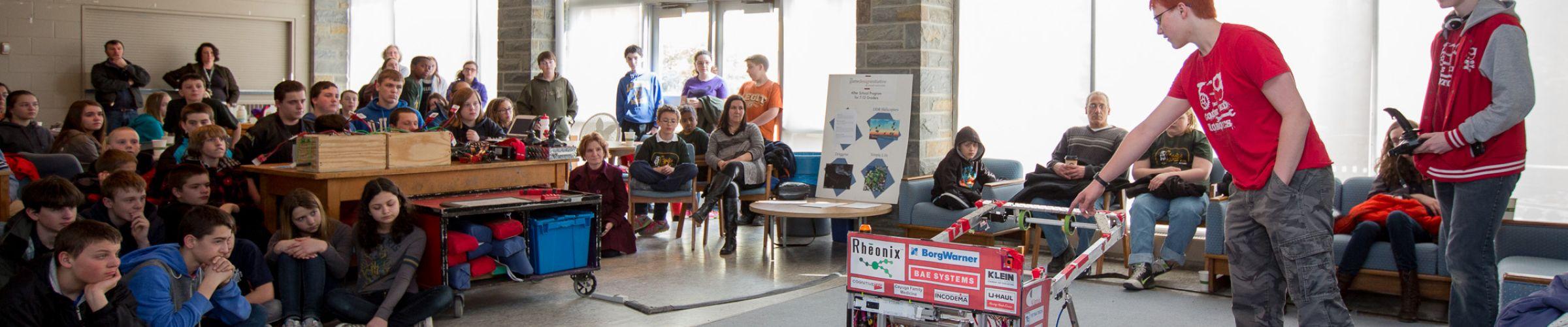 Students demonstrating robots at BOOM