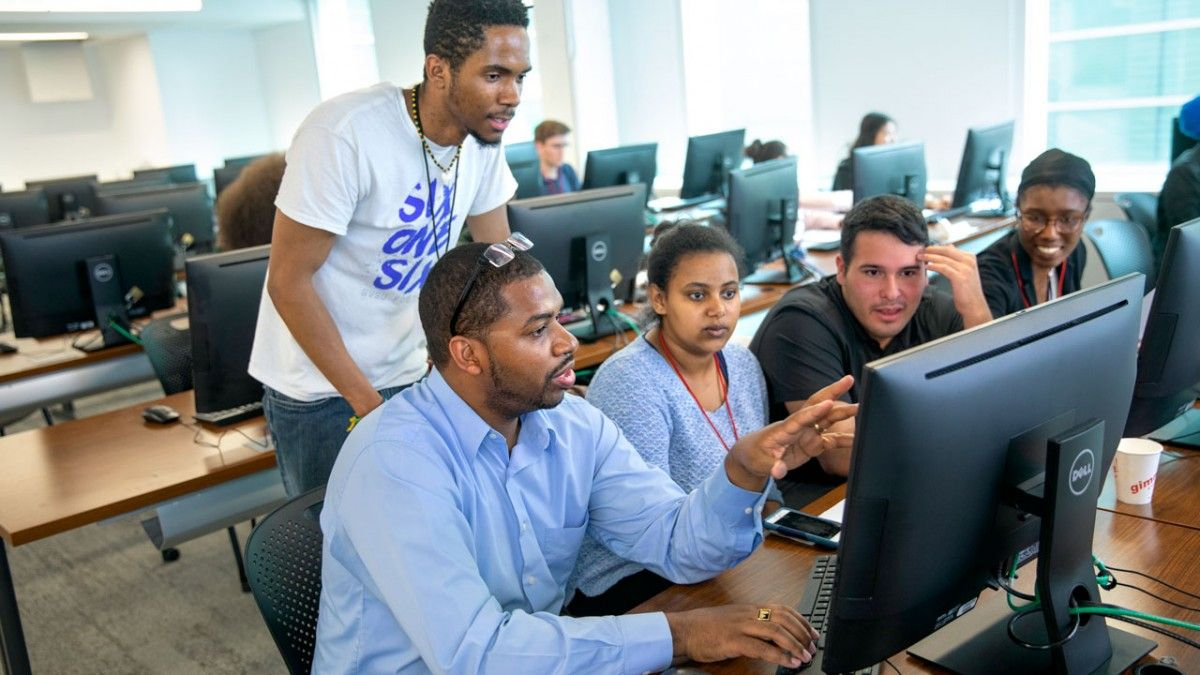 Hakim Weatherspoon, professor of computer science, works with students during the 2019 SoNIC Workshop program in Upson Hall. CREDIT: Jason Koski, Cornell University