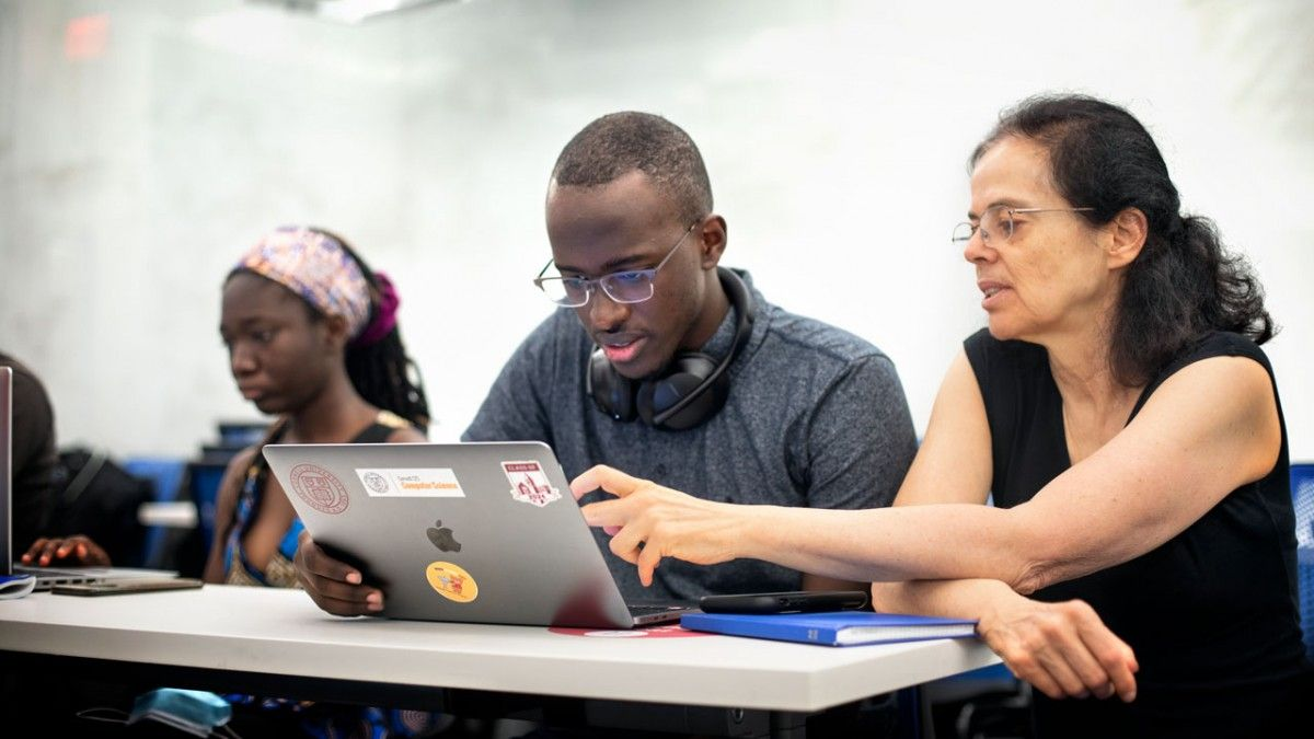 Éva Tardos, the Jacob Gould Schurman Professor of Computer Science, works with students during the 2021 CSMore class in Gates Hall.