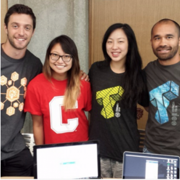 four students at hackathon