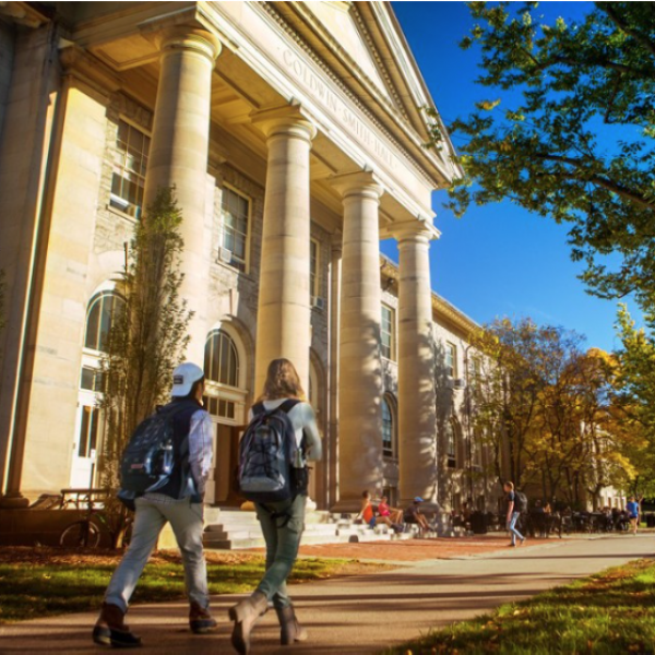 photo of students walking outside of a building