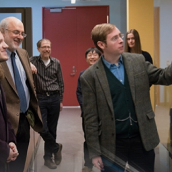 Computer Science Professor and his students discuss their research.