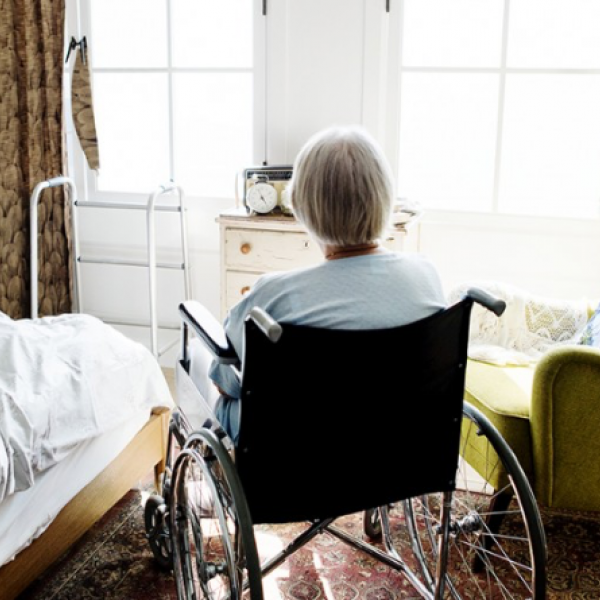 elderly woman in nursing home room