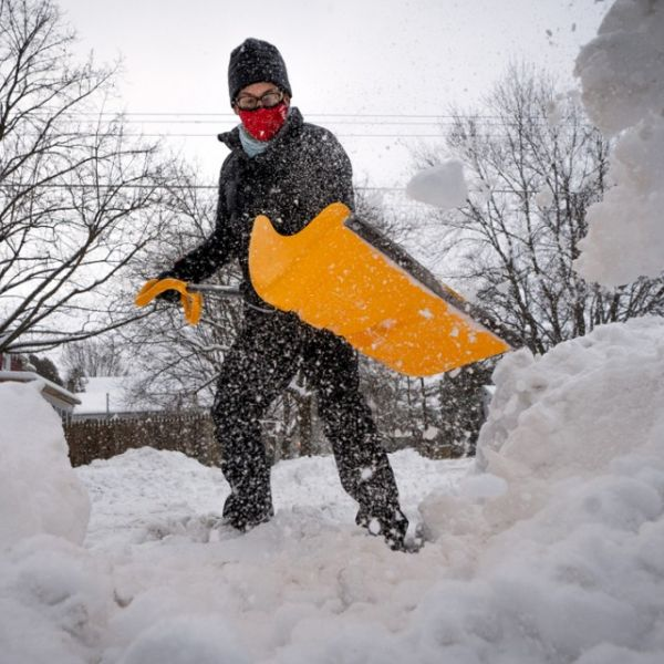Matt Braun, a resident of the Fall Creek neighborhood in the city of Ithaca, shovels snow Feb. 2 at the corner of Tompkins and Utica streets.
