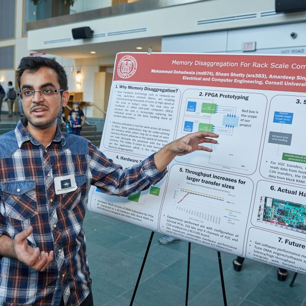 student presenting poster at BOOM