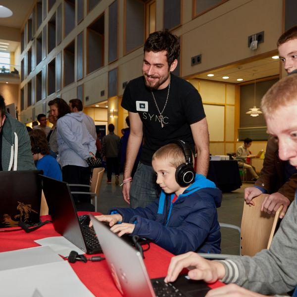 students exploring exhibits at BOOM