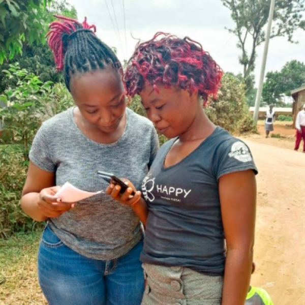 A user tests a new phone-based tool for providing health care feedback with a member of the research team.