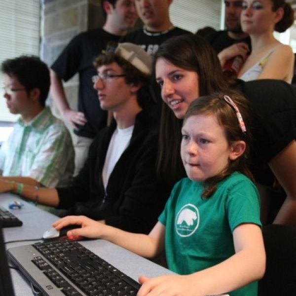 A child demoing a videogame at a previous Cornell Game Design event.